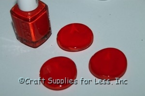 clear glass gems painted orange with polish