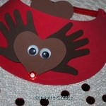 reindeer visor with hand antlers and heart face