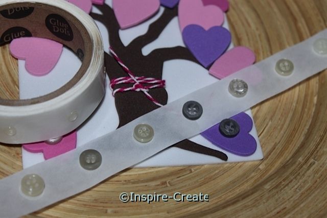 add buttons to mini glue dots and then press onto heart shapes