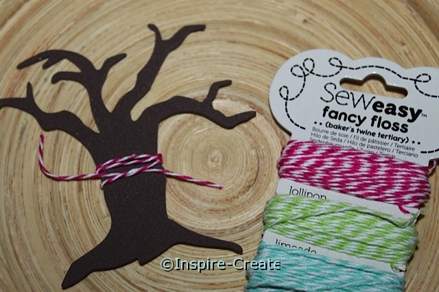 tie bakers twine around tree trunk