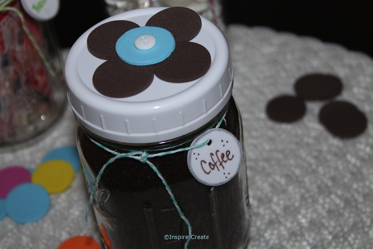 mason jar with a flower lid filled with coffee