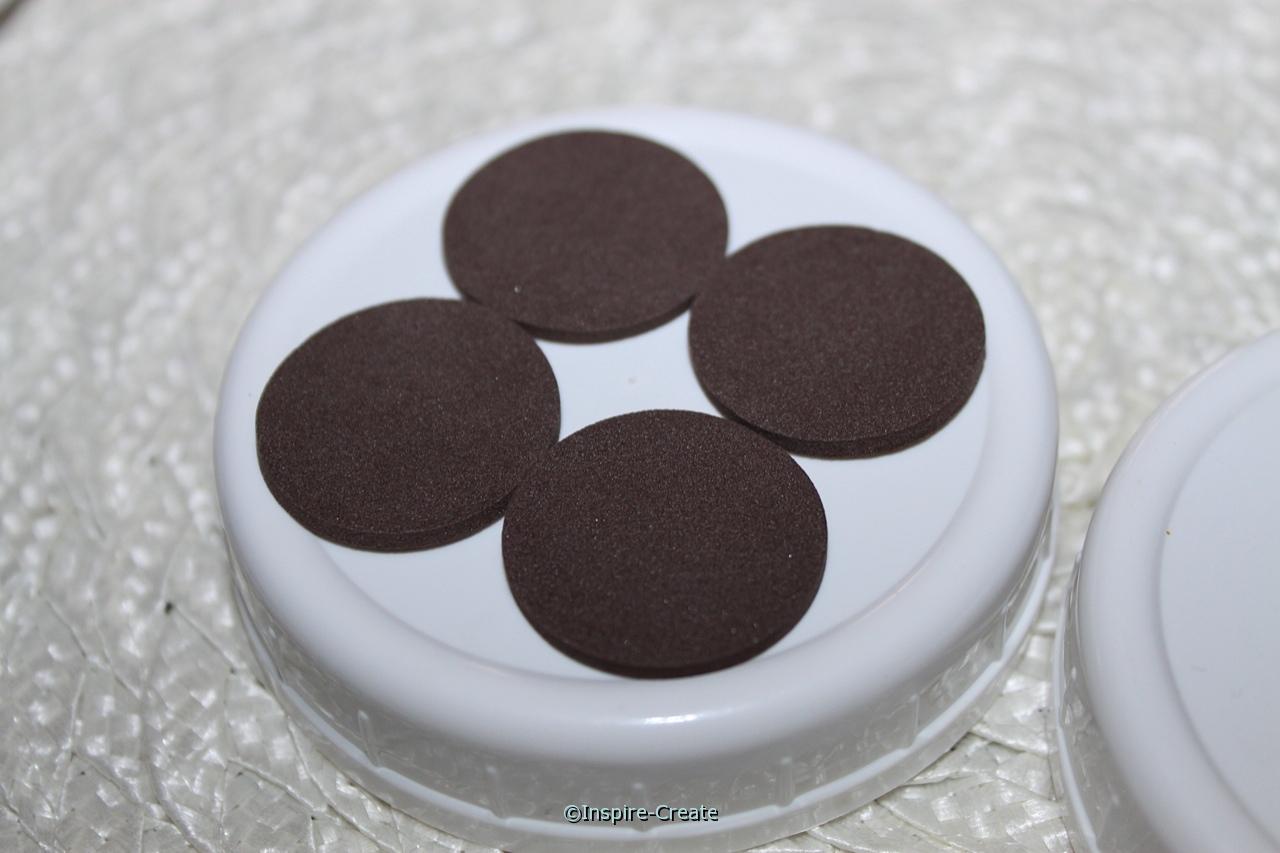 add brown circles to mason jar lid with glue dots