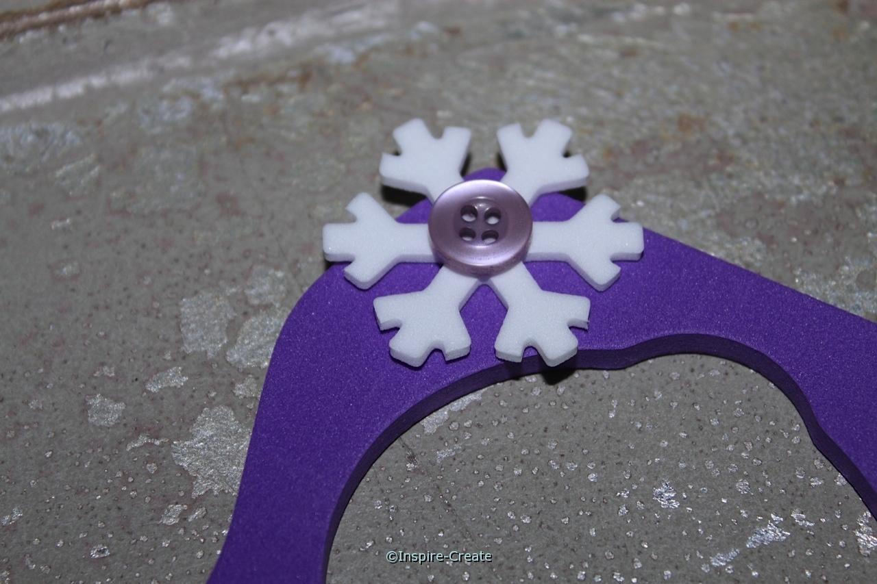 add small snowflake to top of door hanger