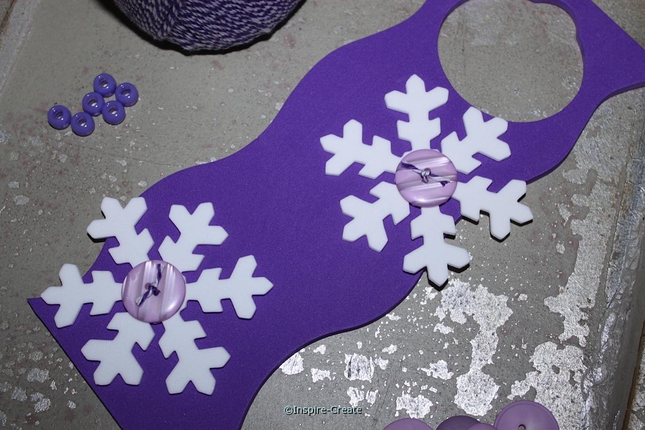 add large snowflakes to door hangers