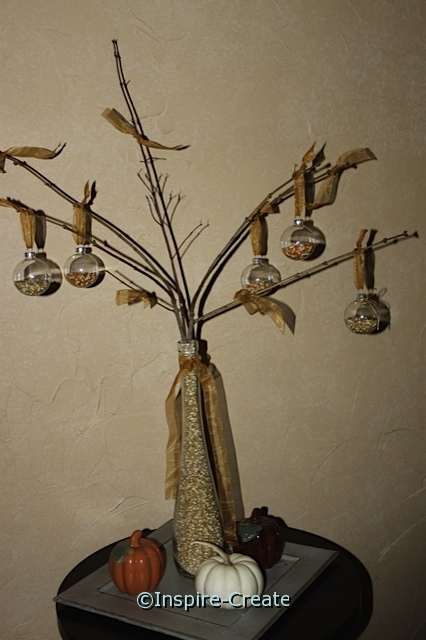 Thanksgiving Centerpiece Idea... Popcorn Ornaments and a Vase