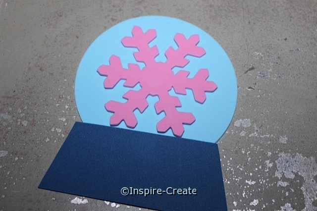 Add a Large Snowflake to the center of the Snow Globe.