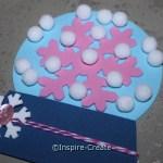 Attach Mini White Pom Poms to the Snow Globe with Mini Glue Dots... No mess!