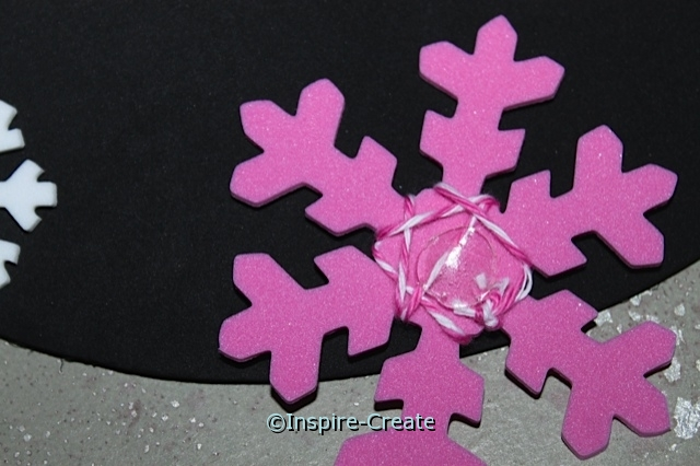 The back of the hot pink snowflake with a glue dot.