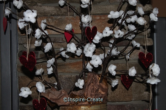 Hang Glitter Hearts on lighted flowers for a great Valentine's Decoration!
