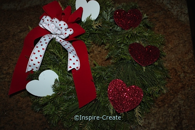 Valentine's Wreath made from Christmas Wreath...Remove pine cones, add Glitter Hearts!