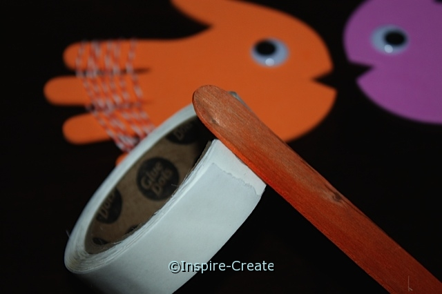 Fish Stick Puppets made with craft foam hands and jumbo craft sticks.
