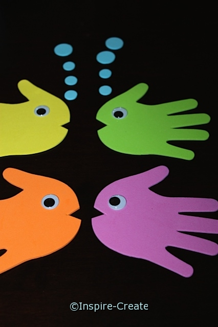 Fish Stick Puppets made with handprints
