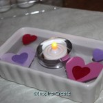 Use small tins to float candles for centerpieces