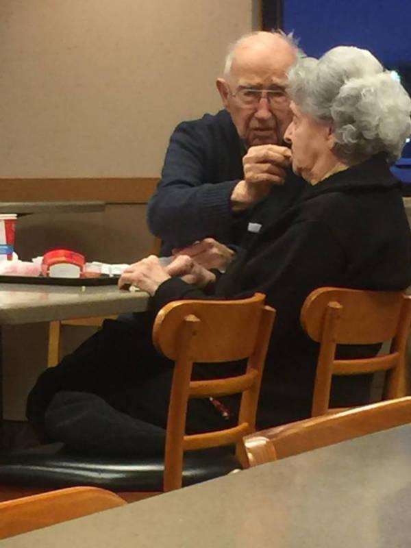 96-year-old husband feeding wife with alzheimer's