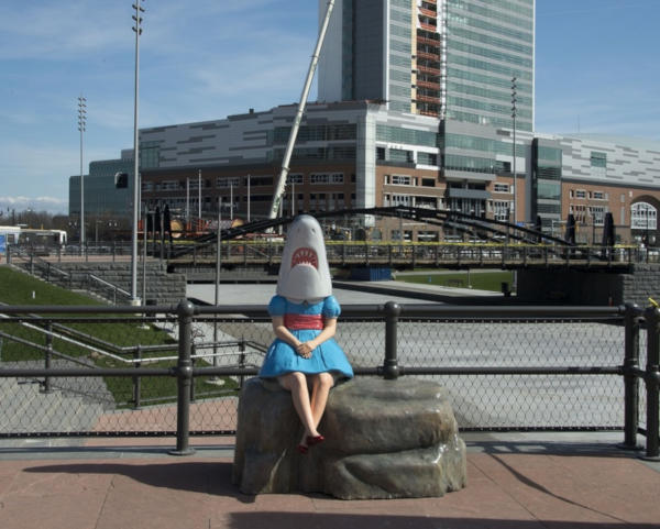 6. Girl with the head of a shark in New York.