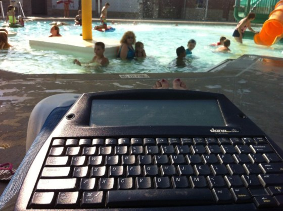 Carol's view while writing poolside as her kids swim.