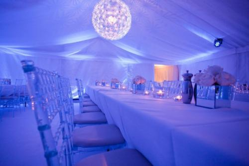 Ice chivaris and architectural lighting in a white carpeted framed marquee in a muddy farmyard!
