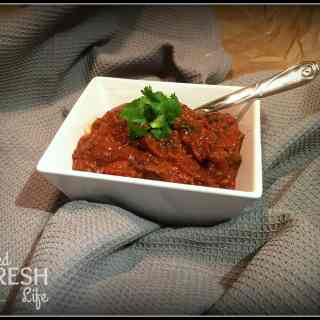 Slow Cooker Chili in a square white bowl with parsley garnish