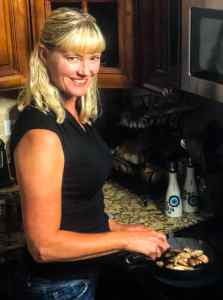 Brandi cooking at the stove in her kitchen.