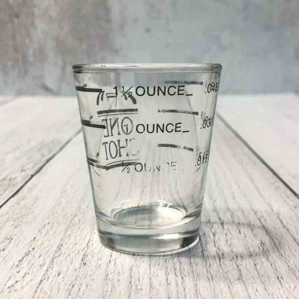 Photo of a measured shot glass to make measuring cocktails super easy.