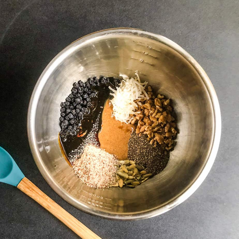 All ingredients in a stainless steel bowl with a spoon laid next to it.