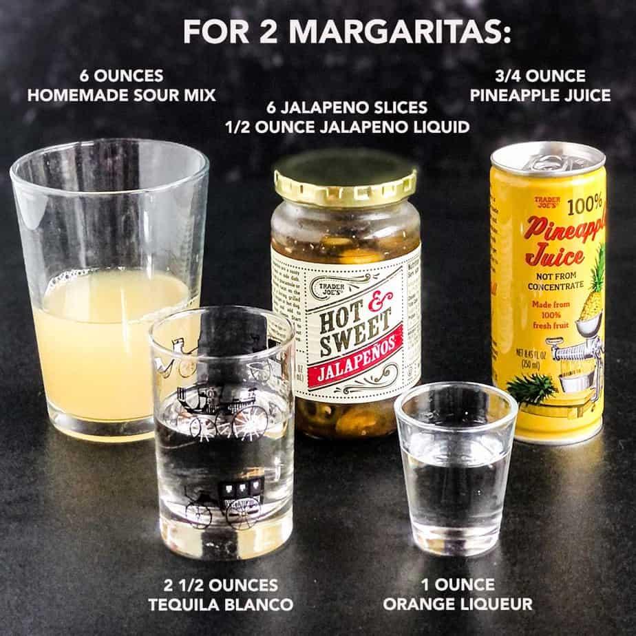 Ingredients for jalapeno margaritas on a black background.