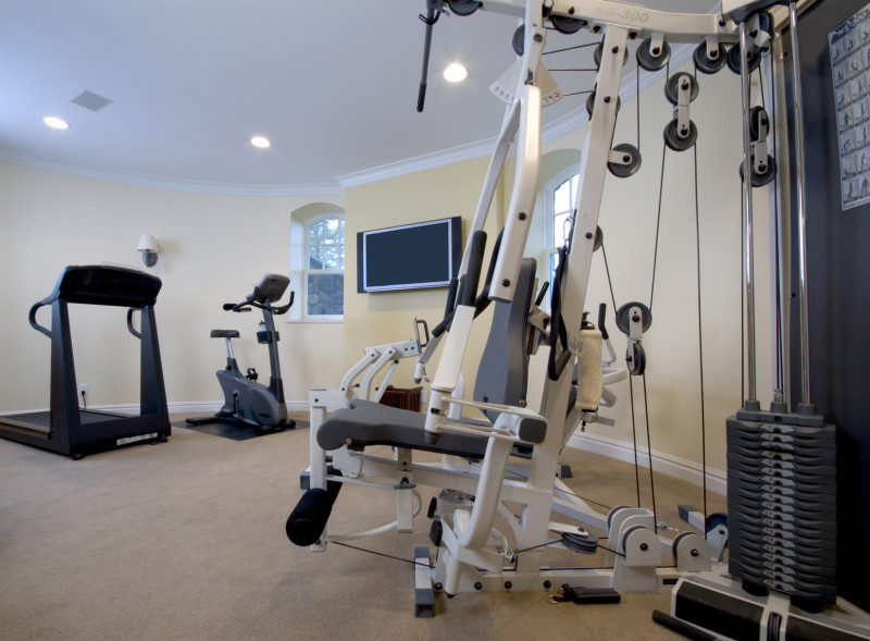 home gym setup in basement of luxury home