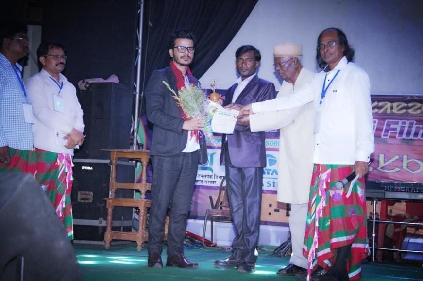 Multi Talented Historic Director Kiran Khatiwada Receiving Best Cinematographer 8th Santhali  RASCA Awards 2017 Jharkhand