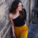 Occasional wear for the spring races and holiday season with Marks and Spencer, pictured are velvet mustard pants, one shoulder bow top, bow velvet mules and box bag worn by Inspiring Wit fashion blogger Jenelle