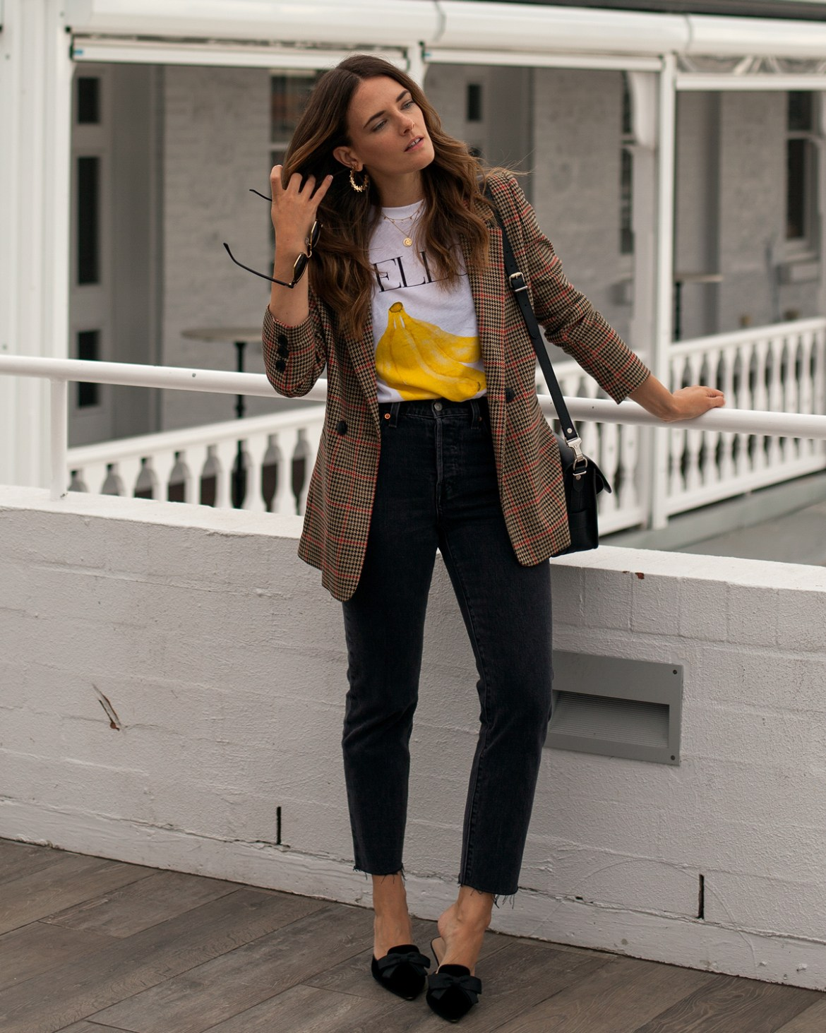 Inspiring Wit fashion blogger Jenelle wearing Anine Bing brown check plaid blazer, Ganni t-shirt, Levi's jeans, velvet bow kitten heels