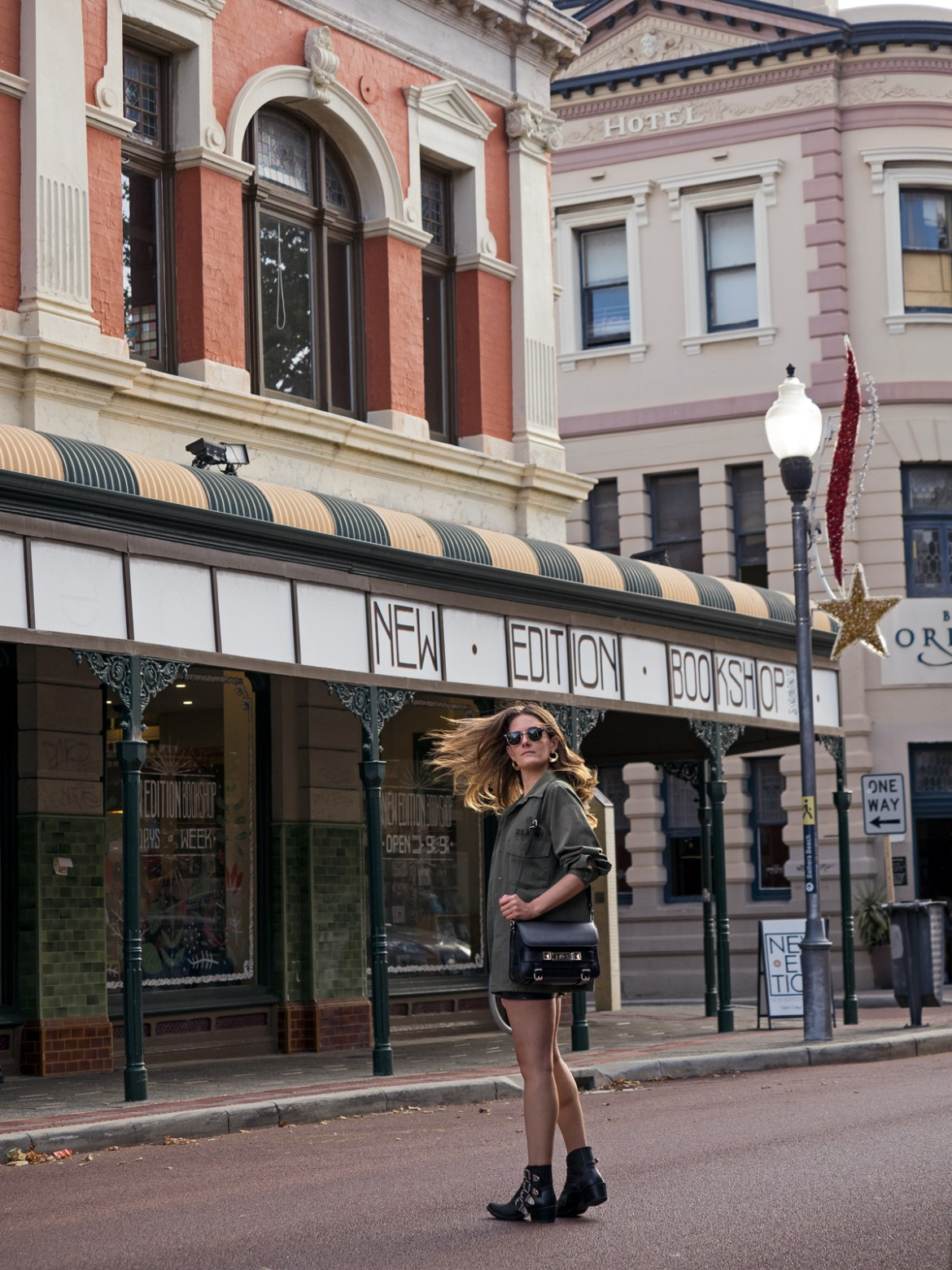 Aje leather mini skirt with army jacket worn by Jenelle Witty of Inspiring Wit fashion and travel blog in Fremantle