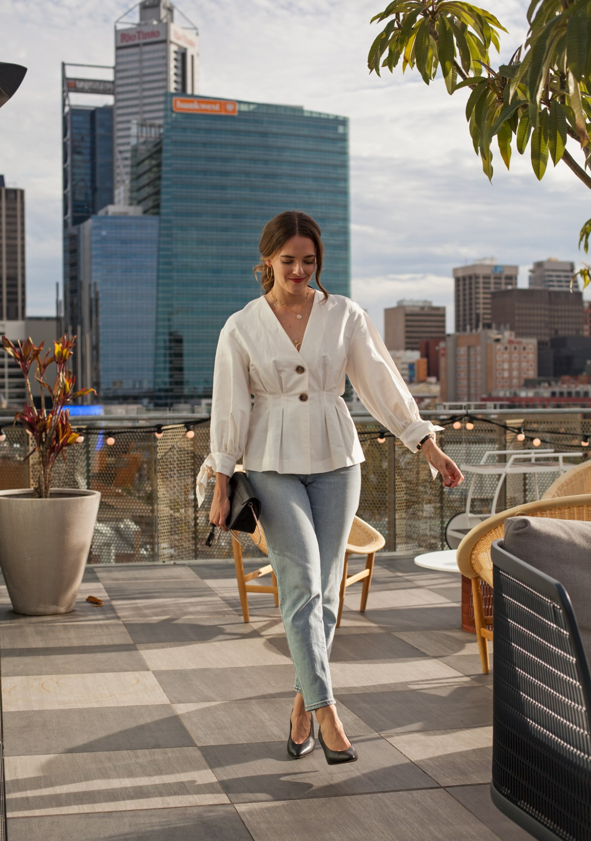 Zara top and Abrand jeans worn by Jenelle from Inspiring Wit blog on the rooftop of Alex Hotel Perth