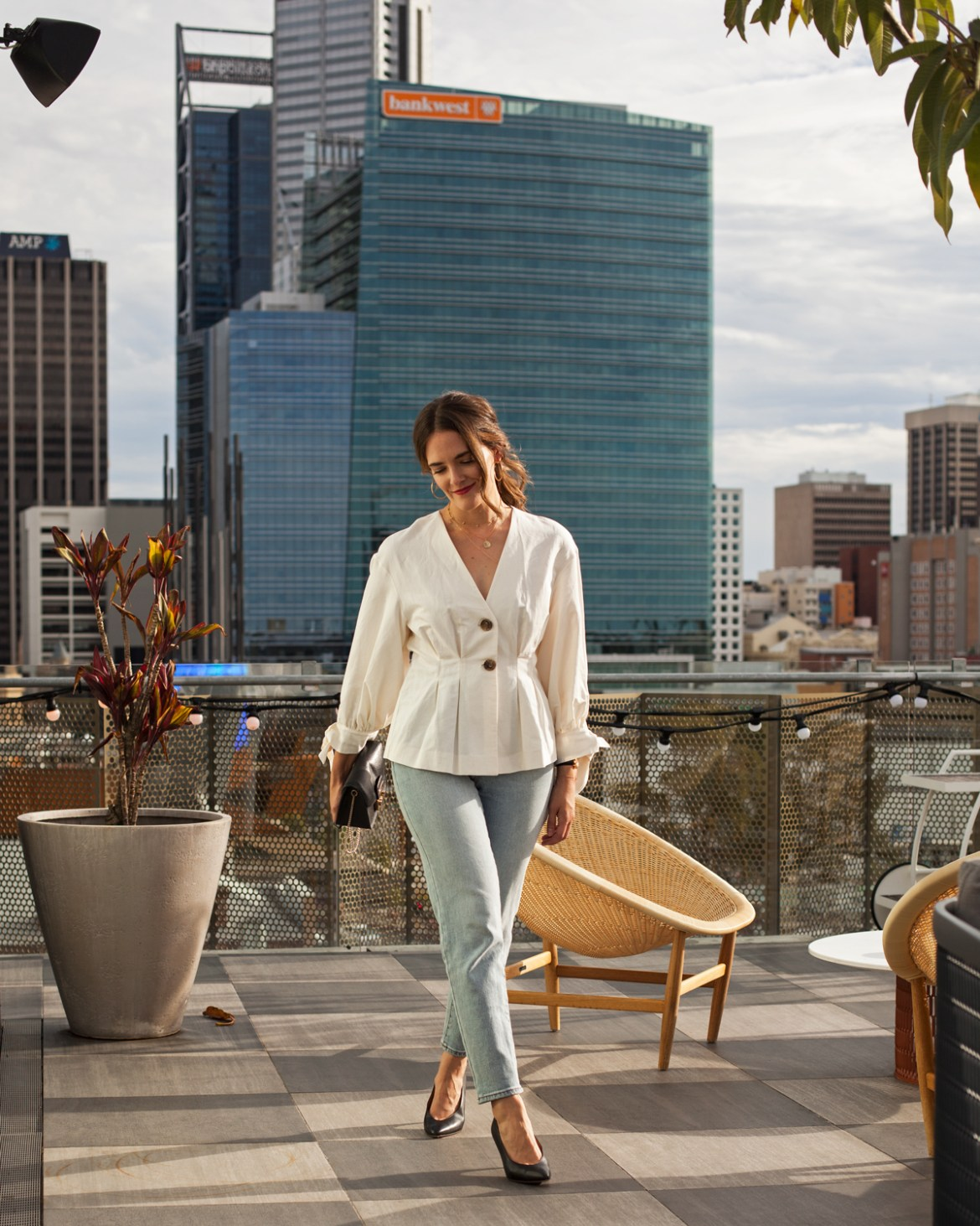 Zara top and Abrand jeans, Furla bag worn by Jenelle from Inspiring Wit blog on the rooftop of Alex Hotel Perth