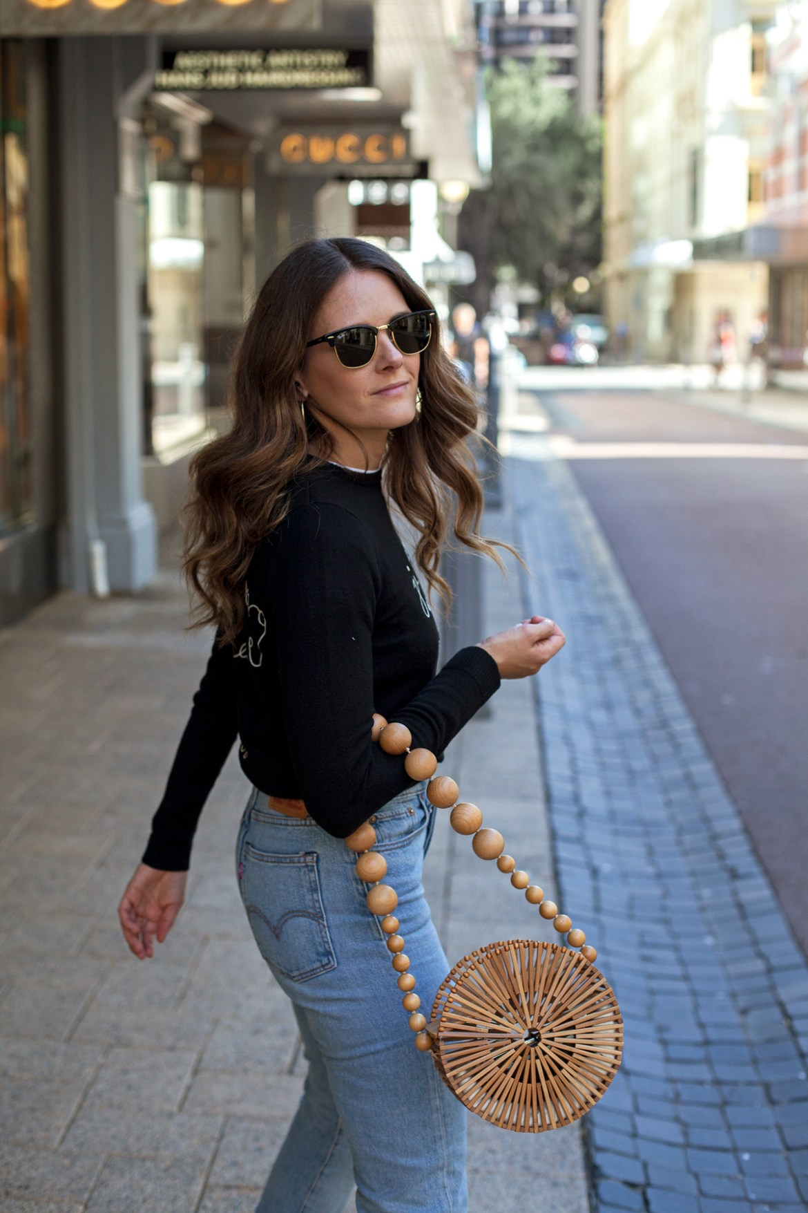 Bella Freud Je T'Aime Jane Sweater Jo Malone silver boots, Levi's wedgie jeans and Cult Gaia bamboo circle bag worn by Inspiring Wit blogger Jenelle