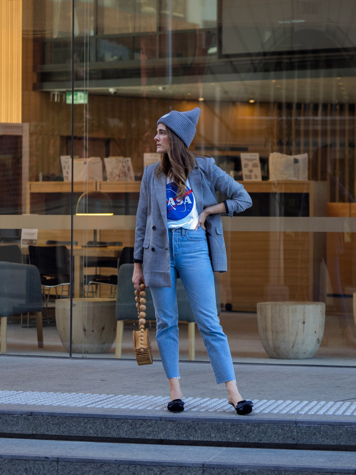 Inspiring Wit blogger Jenelle Witty wearing Acne Studios wool hat and Cult Gaia bamboo circle bag. Since the weather is doing it, so am I. How to mix the best of summer and winter because seasonal dressing is a mess right now.
