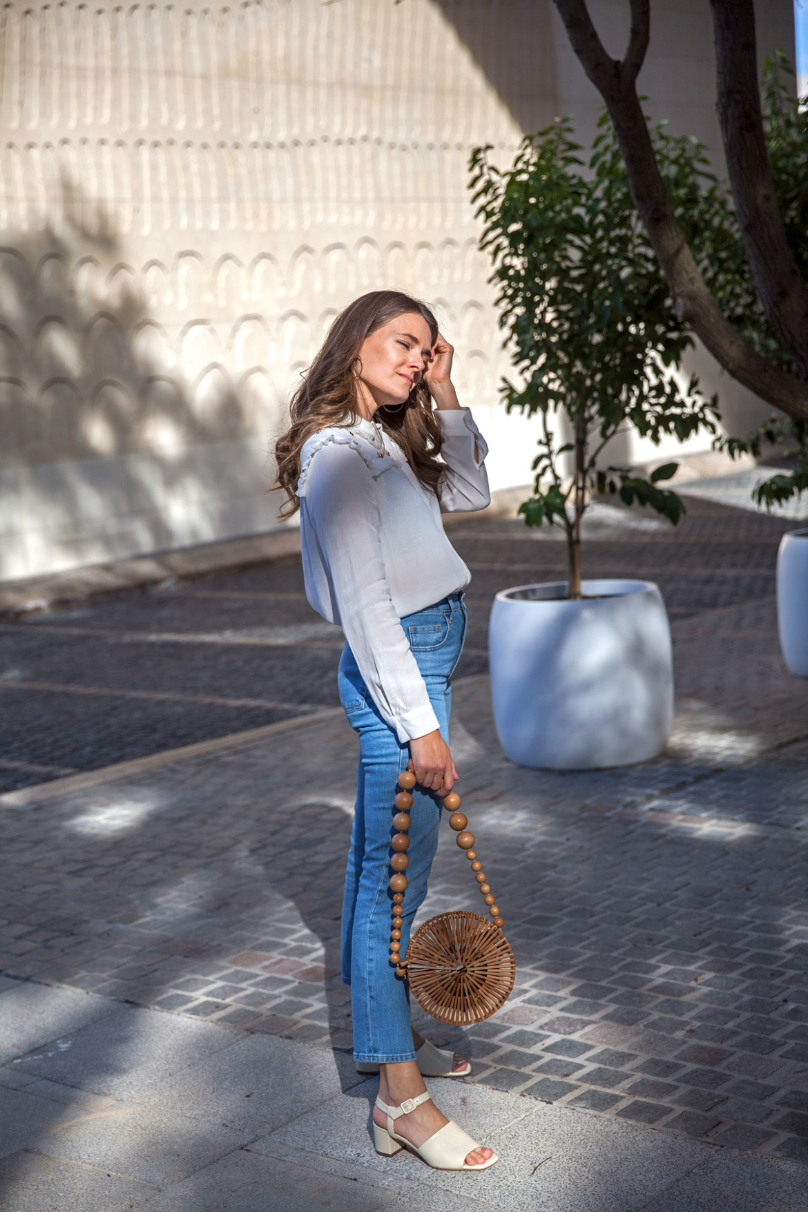 Everlane straight jeans in blue and block heel sandals with Cult Gaia circle bag worn by Inspiring Wit fashion blogger