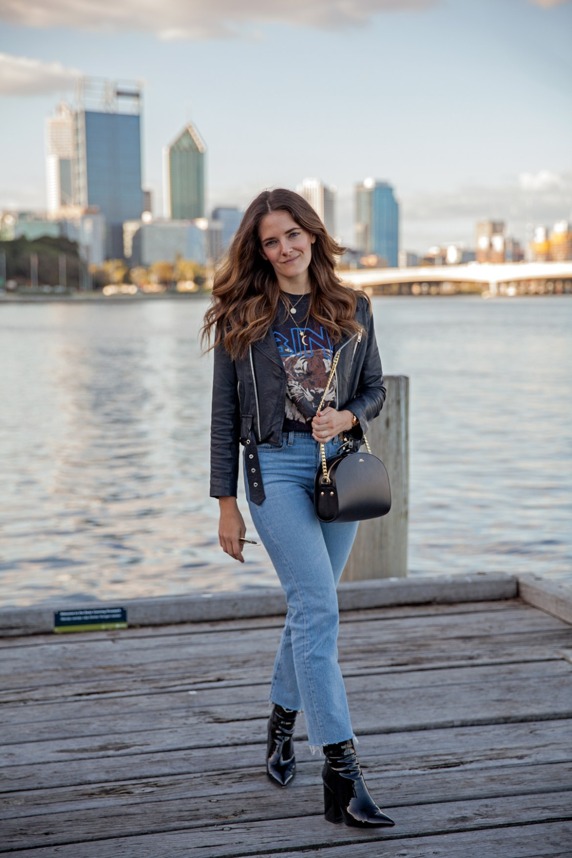 Anine Bing graphic tee, Levi's jeans, leather jacket and Alias Mae patent leather boots worn by Jenelle Witty, fashion blogger from Inspiring Wit in Perth