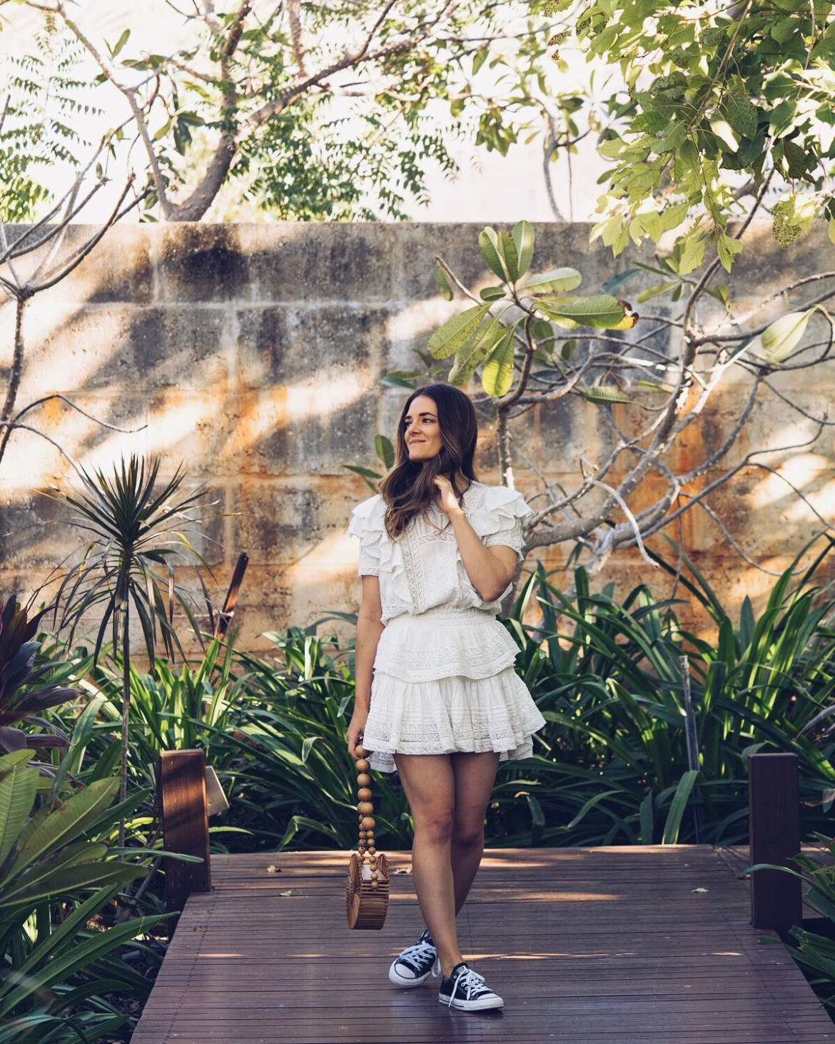 LOVESHACKFANCY little white summer dresses edit with Cult Gaia round bag and Converse sneakers worn by Inspiring Wit Australian fashion blogger Jenelle