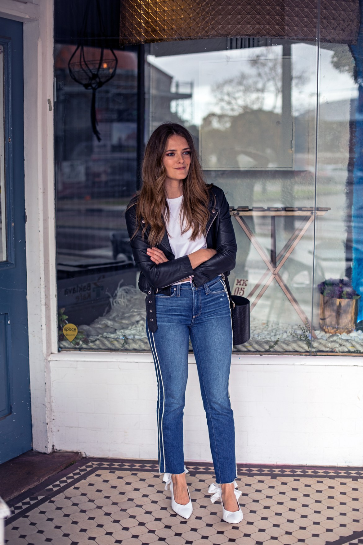 Jenelle Witty from Inspiring Wit blog in Paige jeans, Jac + Jack white basic t-shirt and leather jacket with Ganni white bow heels