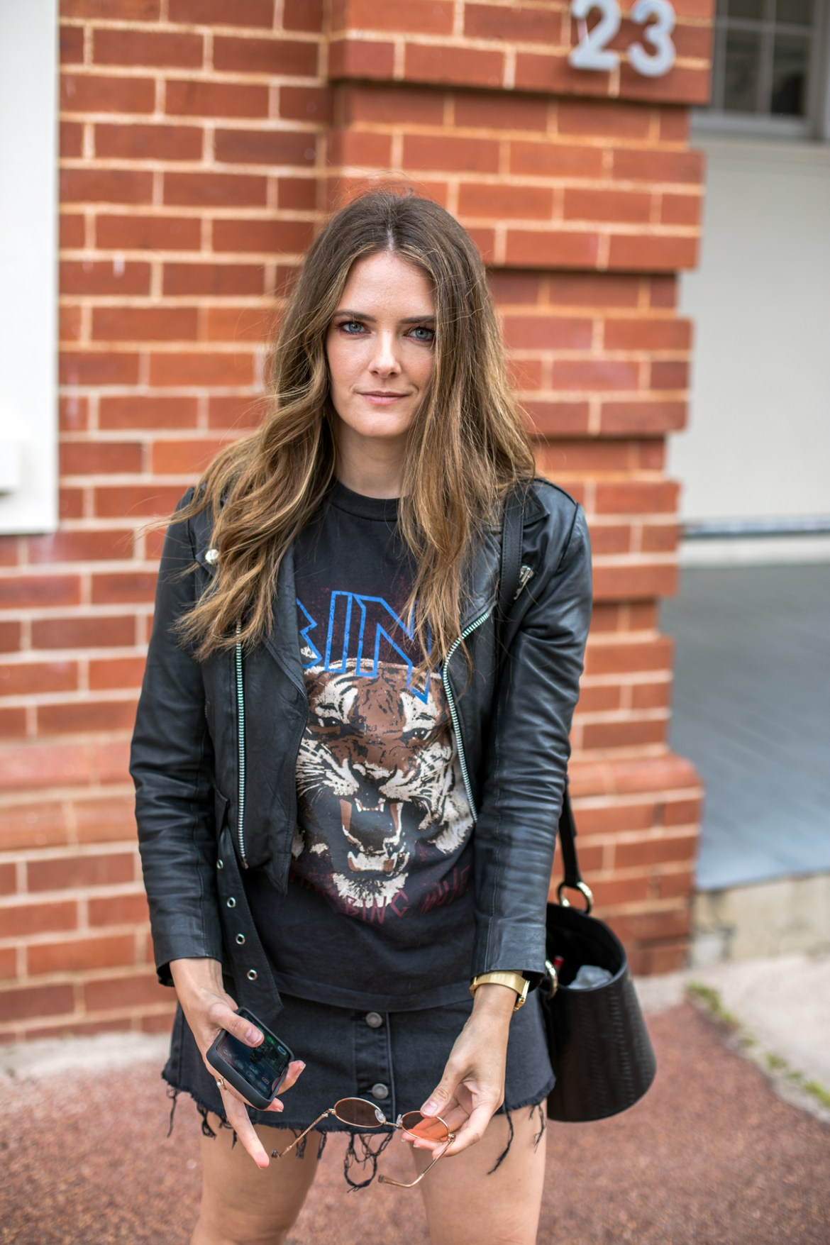 Anine Bing tiger tee with a leather jacket, Quay Australia rose coloured sunglasses and denim skirt worn by Jenelle from Inspiring Wit blog