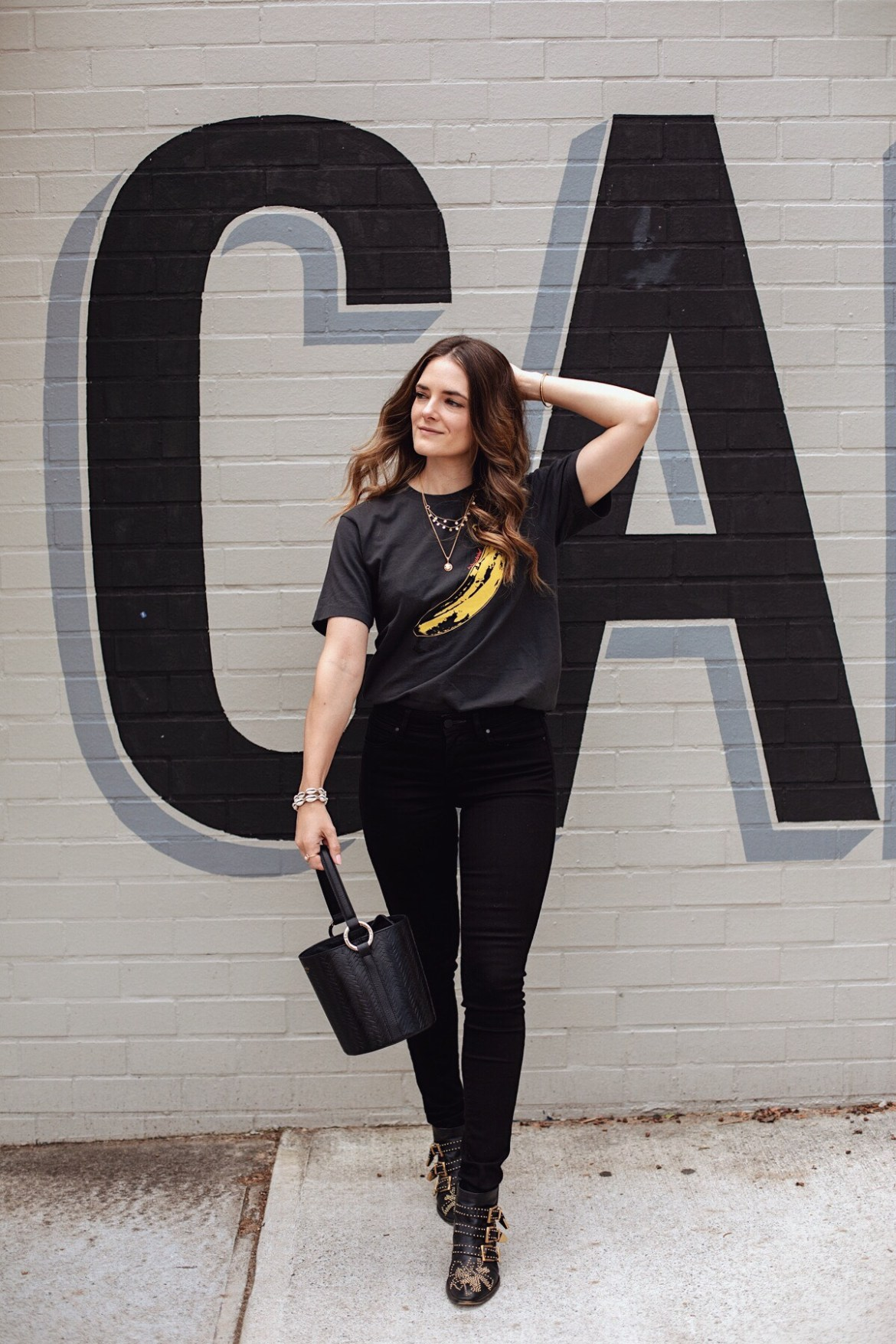 Uniqlo graphic t-shirt UT Andy Warhol banana Inspiring Wit blogger Jenelle Witty in the Chloe Susanna studded boots Uniqlo black jeans and Uniqlo SPRZ tee
