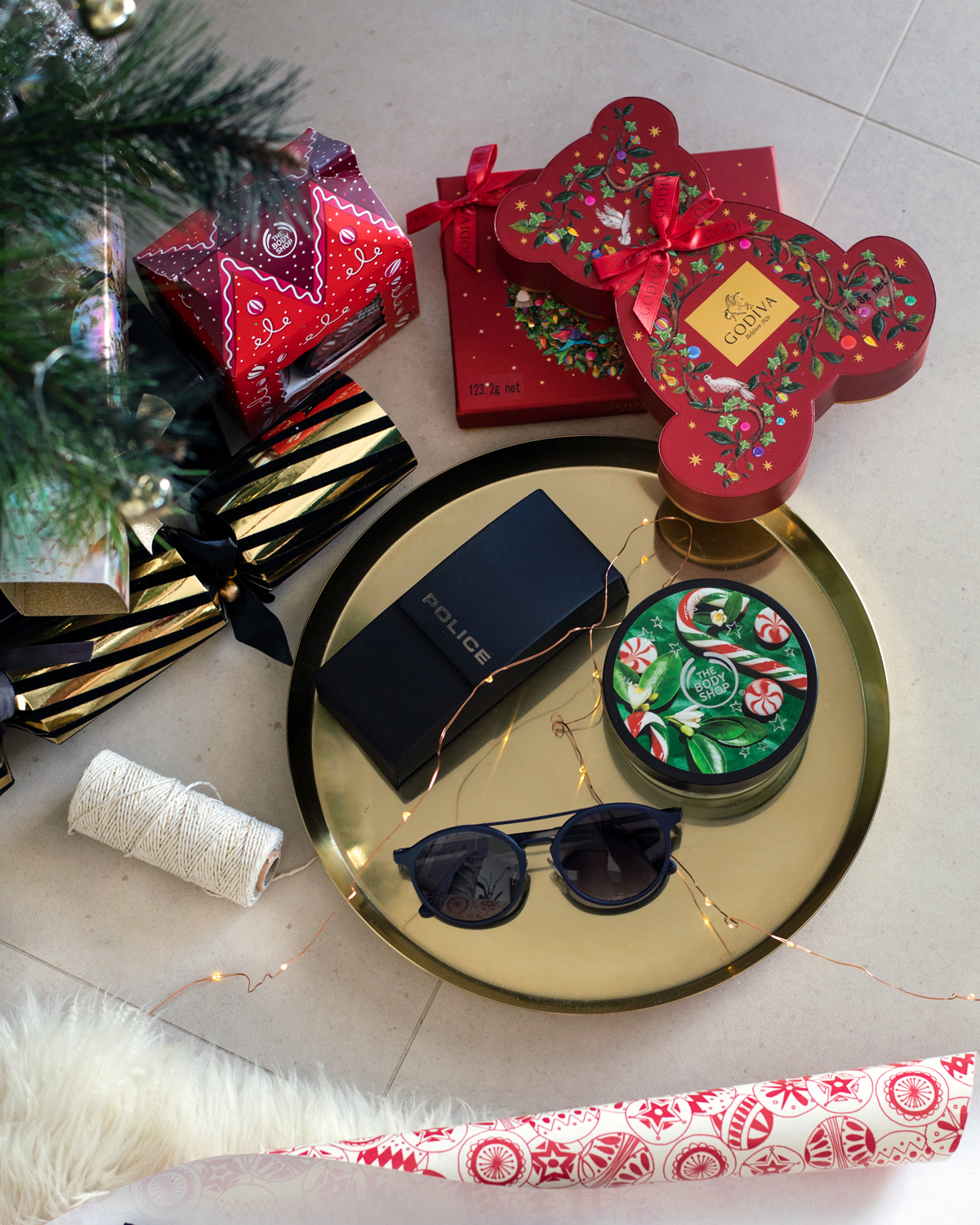 2018 Christmas gift guide Inspiring Wit blog featuring men's gifts Police eyewear sunglasses with The Body Shop Candy Cane body lotion and Godiva Chocolates