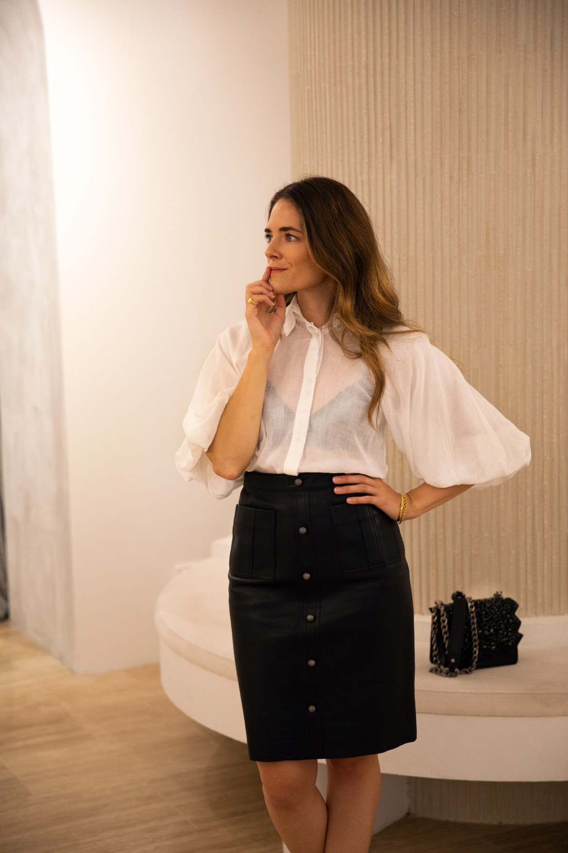 Aje leather skirt and puff sleeve shirt from Autumn 19 collection worn by Inspiring Wit fashion blogger Jenelle
