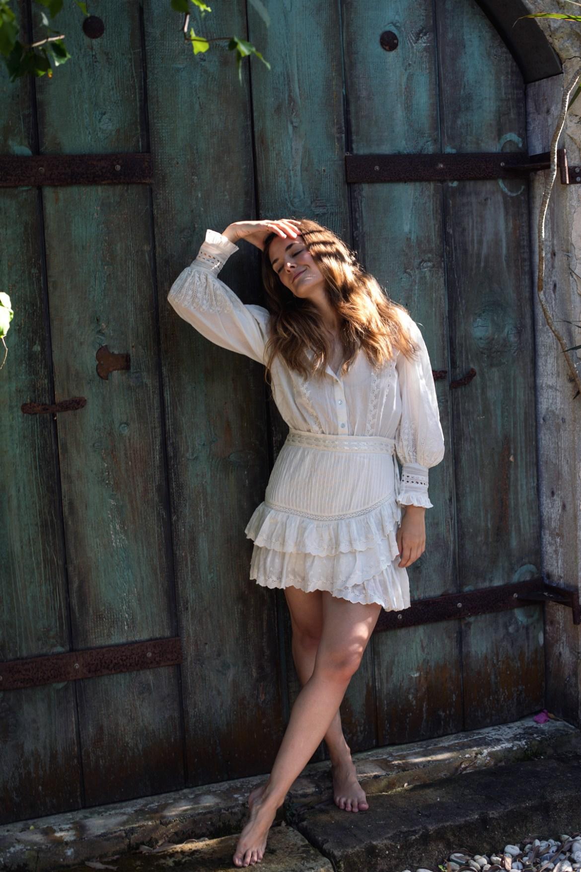 Loveshackfancy Lorelei dress white ruffle dress with puff sleeves worn by Inspiring Wit fashion blogger Jenelle