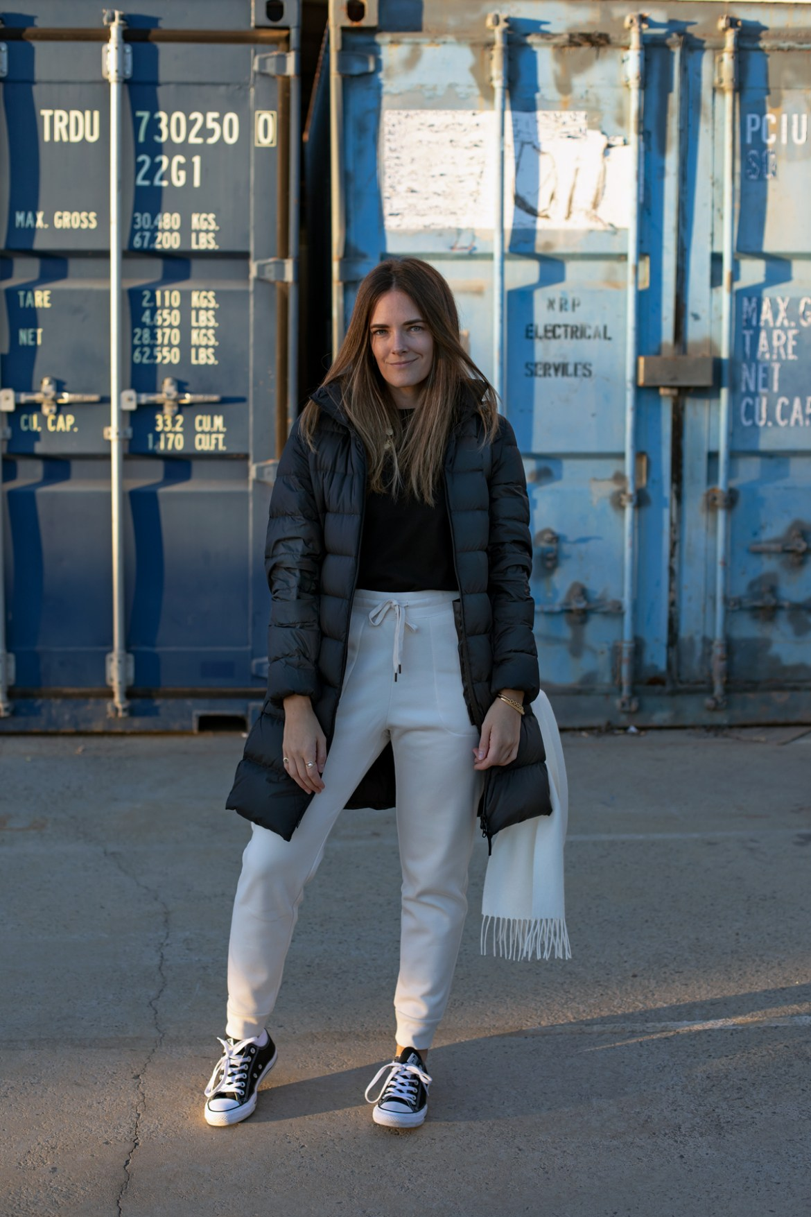 casual outfit ideas for winter. black Uniqlo Ultra Light Down (ULD) hood coat outfit with black tee and cream jogger pants worn by Jenelle from the blog Inspiring Wit.
