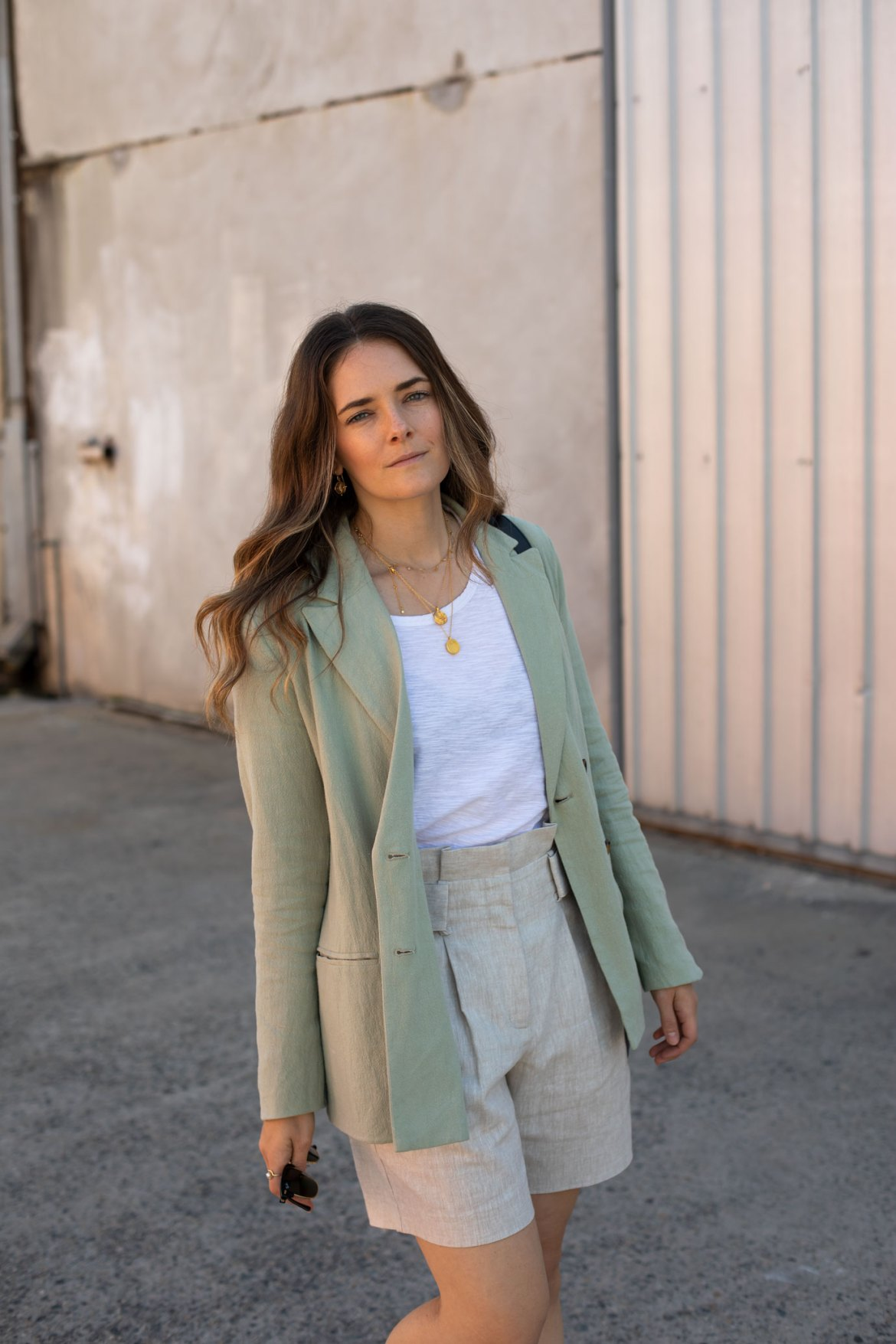 casual neutral linen look with gold necklaces