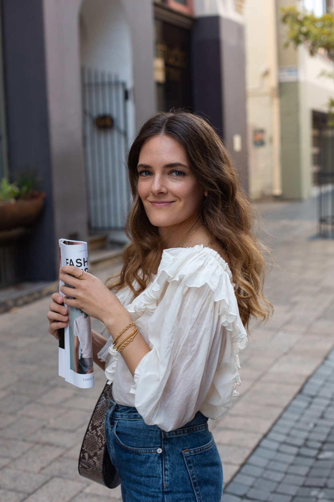 luxury fashion blogger Jenelle Witty from Inspiring Wit wearing Innika Choo cotton ruffle top with Astley Clarke gold bangles