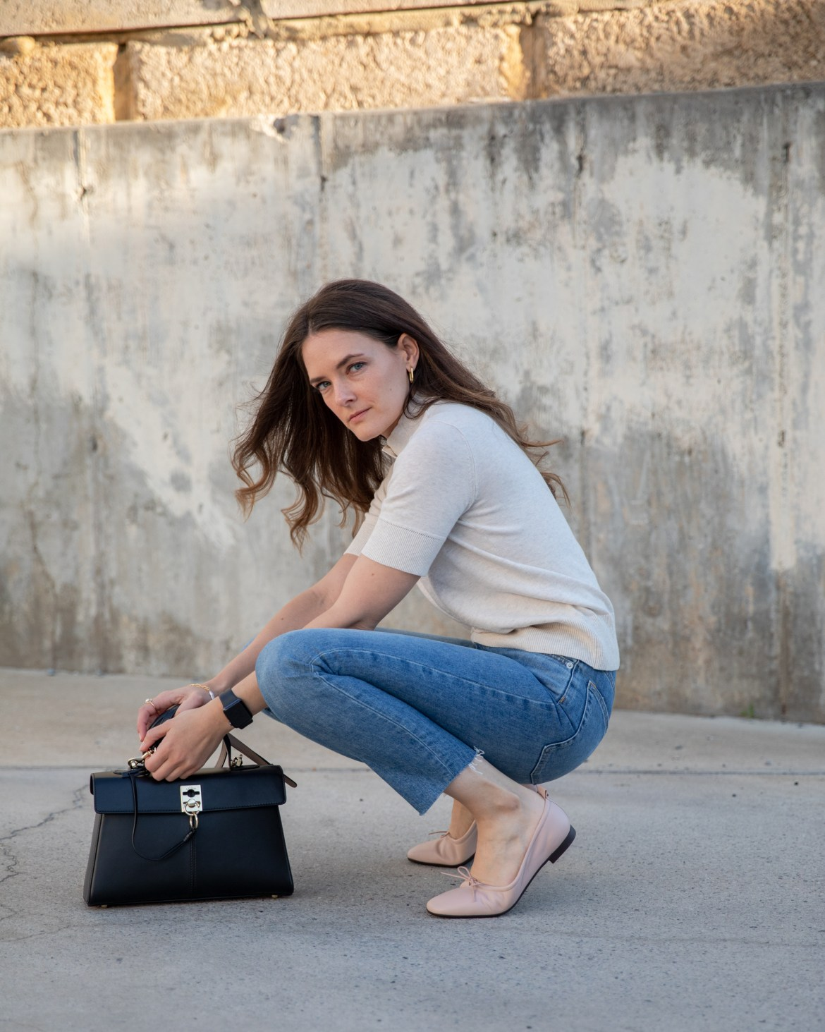 Ballet flats with jeans outfit idea with a knit top