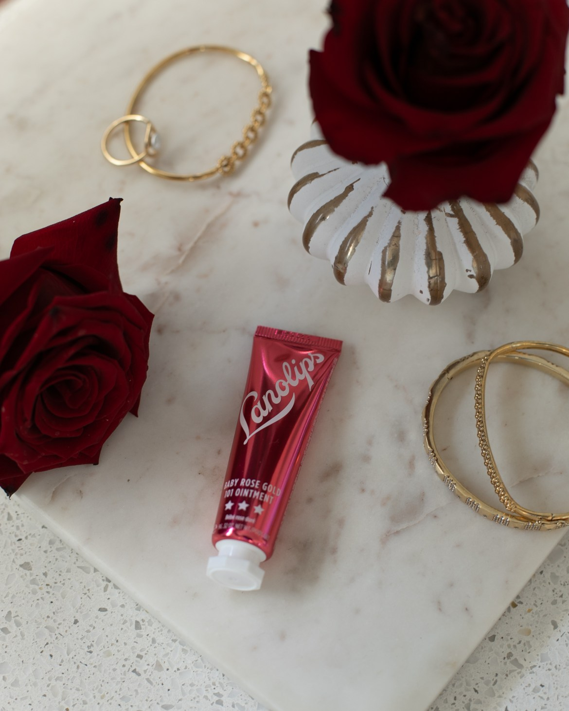 Lanolips baby rose gold ointment for a natural beauty look for Valentine's Day