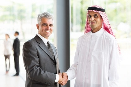 successful senior businessman handshake with Arabian partner